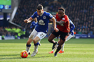 Seamus Coleman of Everton get away from Saido Berahino of West Bromwich Albion. Barclays Premier League match, Everton v West Bromwich Albion at Goodison Park in Liverpool on Saturday 13th February 2016.<br /> pic by Chris Stading, Andrew Orchard sports photography.