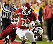 Nov 5, 2011; Fayetteville, AR, USA;  Arkansas Razorback wide receiver Cobi Hamilton (11) carries the ball as South Carolina Gamecock strong safety D.J. Swearinger (36) attempts the tackle during a game at Donald W. Reynolds Stadium.  Mandatory Credit: Beth Hall-US PRESSWIRE
