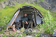 Successful Dall Sheep Hunter in camp with a Ram in a Beautiful Alaskan Valley