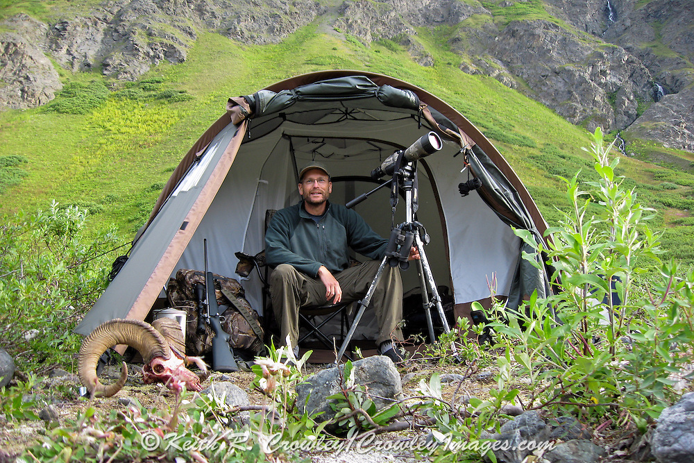 Keith Crowley at base camp with a Ram in a beautiful Alaskan Valley