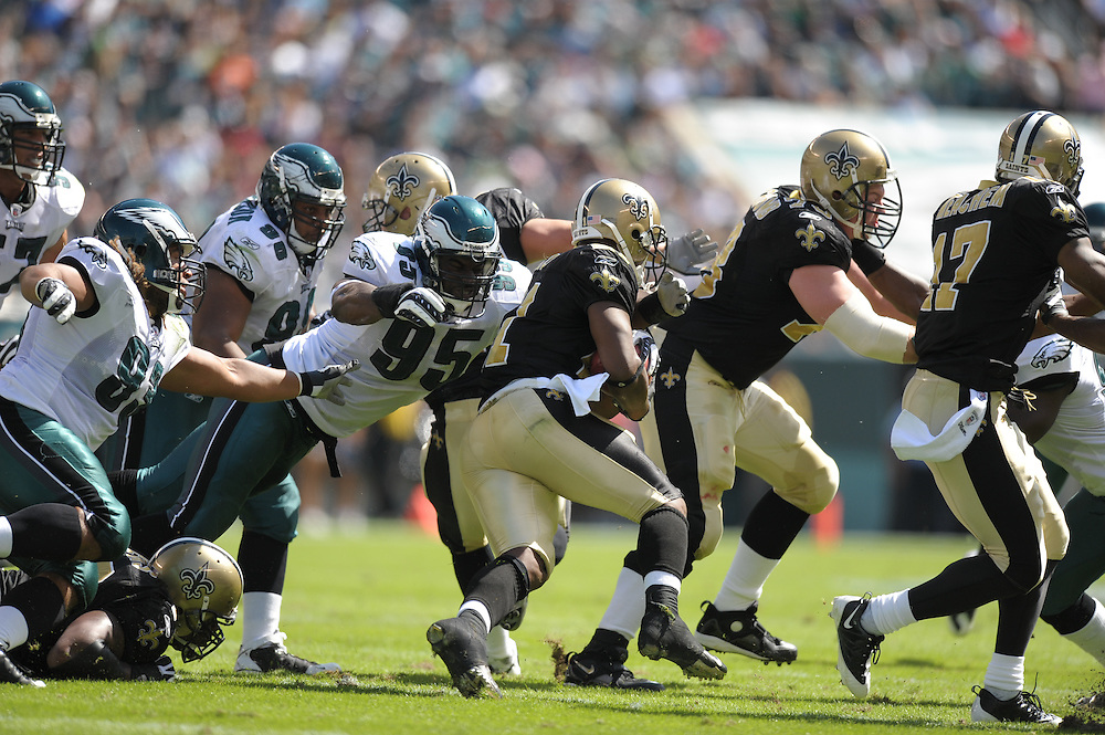 PHILADELPHIA - SEPTEMBER 20: Defensive end Victor Abiamiri #95 of the Philadelphia Eagles dives during the game against the New Orleans Saints on September 20, 2009 at Lincoln Financial Field in Philadelphia, Pennsylvania. (Photo by Drew Hallowell)  *** Local Caption *** Victor Abiamiri