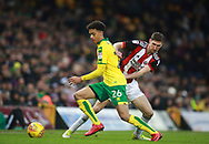 Norwich City's Jamal Lewis and Sheffield United's Chris Basham during the EFL Sky Bet Championship match between Norwich City and Sheffield Utd at Carrow Road, Norwich, England on 20 January 2018. Photo by John Marsh.