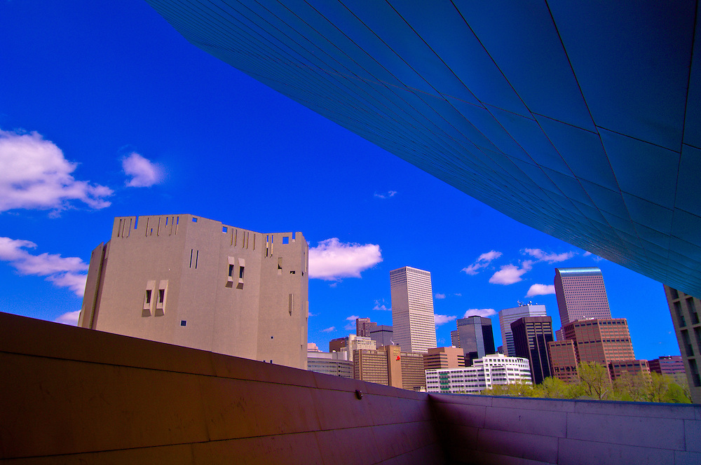 View from the Frederic C. Hamilton Building (designed by Daniel Libeskind) to the Northern Building, Denver Art Museum (with Downtown Denver in background), Civic Center Cultural Complex, Denver, Colorado USA
