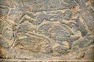 Pictures & images of the North Gate Hittite sculpture stele depicting Hittite swimming with fish. 8th century BC. Karatepe Aslantas Open-Air Museum (Karatepe-Aslantaş Açık Hava Müzesi), Osmaniye Province, Turkey.