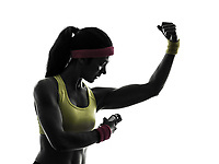 one woman applying deodorant exercising fitness workout in silhouette on white background
