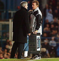Fotball<br /> England 2004/22005<br /> Foto: SBI/Digitalsport<br /> NORWAY ONLY<br /> <br /> Portsmouth v Blackburn Rovers<br /> 15/1/2005<br /> Barclays Premiership<br /> <br /> Blackburn's manager Mark Hughes asks fourth official Mr. P. Taylor where six minutes of extra time have come from.
