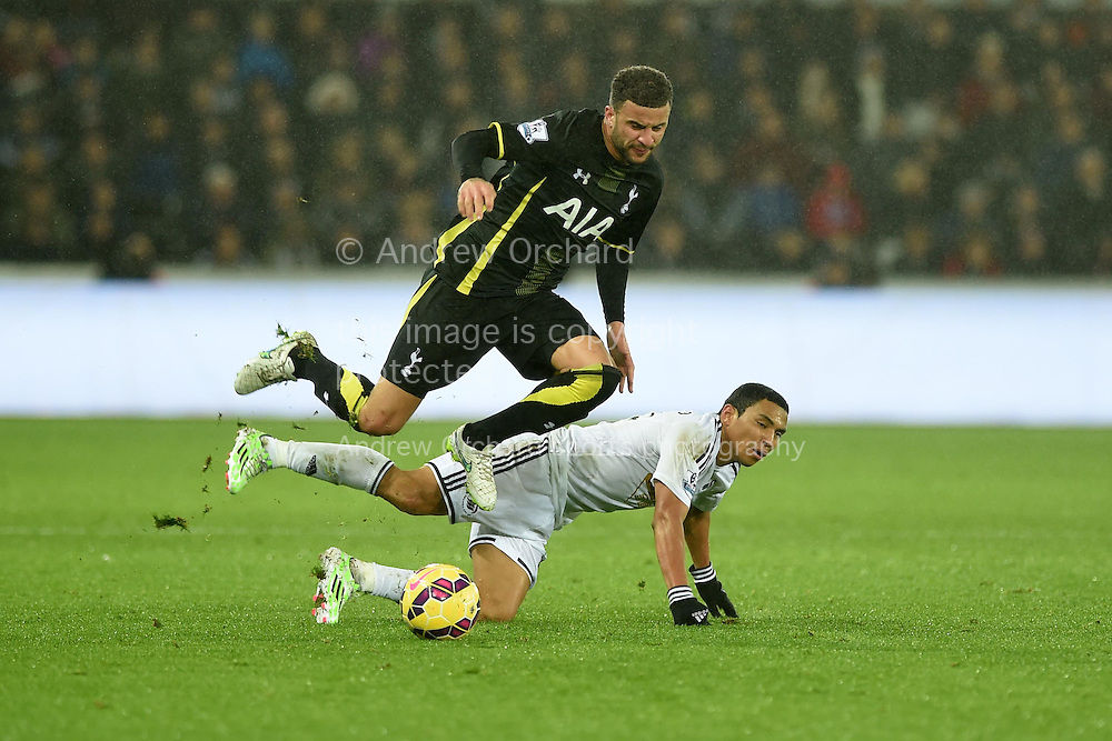 Tottenham's Kyle Walker is tackled by Jefferson Montero of Swansea city.  Barclays Premier League match, Swansea city v Tottenham Hotspur at the Liberty Stadium in Swansea, South Wales on Sunday 14th December 2014<br /> pic by Andrew Orchard, Andrew Orchard sports photography.