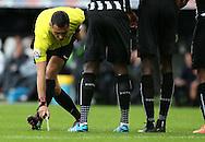 Referee Andre Marriner uses his marker spray - Barclays Premier League - Newcastle Utd vs Liverpool - St James' Park Stadium - Newcastle Upon Tyne - England - 1st November 2014  - Picture Simon Bellis/Sportimage
