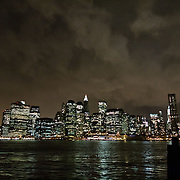 Manhattan skyline by night seen from Brooklyn.