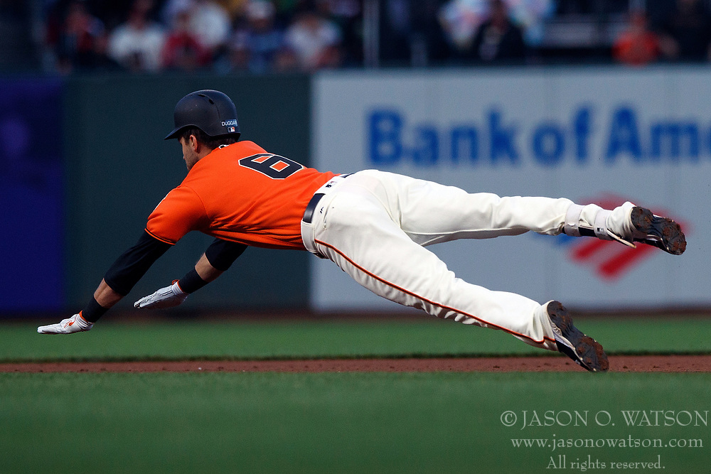 SAN FRANCISCO, CA - JULY 13: Steven Duggar #6 of the San Francisco Giants dives into second base for a double against the Oakland Athletics during the fourth inning at AT&T Park on July 13, 2018 in San Francisco, California. The San Francisco Giants defeated the Oakland Athletics 7-1. (Photo by Jason O. Watson/Getty Images) *** Local Caption *** Steven Duggar