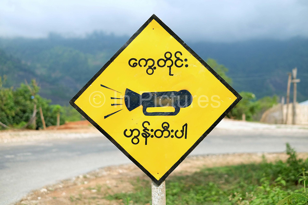 Honk your horn as you travel around the sharp curve road sign on 19th May 2016 in Myanmar