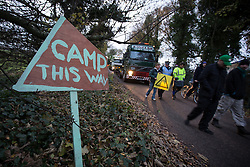 © Licensed to London News Pictures . 27/11/2013 . Manchester , UK . Protesters in front of lorries leaving the site . Energy firm IGas have today (Wednesday 27th November 2013) been receiving drilling equipment in readiness for exploratory drilling at the site . Anti fracking protesters have established a camp at Barton Moss in Greater Manchester alongside an access road leading to an IGas drilling site .  Photo credit : Joel Goodman/LNP