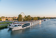River cruise ships docked on the shores of the Rhône river in Avignon, France.