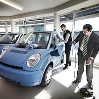 Nederland, amsterdam , 8 maart 2011..Dhr. Isa Kilicarslan, eigenaar van Actief Lease, neemt de komende maanden ongeveer 40 auto's af bij zijn leverancier, allemaal voor kleine ondernemers in Amsterdam. Hij sloot vanmiddag ook een overeenkomst met 'Antoinette zorg': zij huren nu 2 elektrische auto's van Actief Lease, oplopend tot 10 elektrische auto's voor het einde van dit jaar. Dhr. Kilicarslan geeft aan dat er vraag is naar de auto's die hij besteld heeft voor de lease...Actief Lease company buys 40 electric cars for small entrepreneurs inAmsterdam.