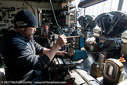 "Koji ""Hammer"" Hamad checks valve springs in hisHammer Sycle /Hardly-Driveable shop inTsuchiura City, Ibaraki Prefecture, Japan. Thursday December 7, 2017. Photography ©2017 Michael Lichter."