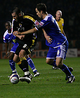 Photo: Steve Bond.<br />Leicester City v Cardiff City. Coca Cola Championship. 26/11/2007. Steve Thompson (L) grapples with Stephen Clemence (R)