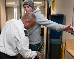 Visitor being searched at the entrance of Sheffield Magistrates' Court