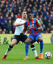 March 31, 2018 - London, Greater London, United Kingdom - Crystal Palace's Wilfried Zaha under pressure from Liverpool's Jordan Henderson.during the Premiership League  match between Crystal Palace and Liverpool at Wembley, London, England on 31 March 2018. (Credit Image: © Kieran Galvin/NurPhoto via ZUMA Press)