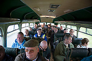 Enthusiasts take a bus ride on one of the vintage buses on open day at Wythall Transport Museum on May 1st 2017 in Wythall, England, United Kingdom. The Transport Museum, Wythall is a transport museum just outside Birmingham, at Wythall, Worcestershire.The museum is run by the charity The Birmingham and Midland Motor Omnibus Trust BaMMOT. The museum has three halls, presenting a significant collection of preserved buses and coaches, including Midland Red and Birmingham City Transport vehicles. It is also home to the Elmdon Model Engineering Society EMES who operate the Wythall miniature railway within the grounds of the transport museum, giving rides to public on miniature steam trains.