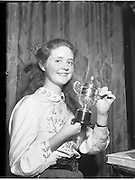 07/11/1959<br /> 11/07/1959<br /> 07 November 1959<br /> All Ireland Final of Gael Linn Children's Singing Competition at Francis  Xavier Hall, Dublin. Picture shows the smiling prize winner 16 year old Aine Ní Rinn of Millstreet, Co. Cork, winner of the 1st prize of a solid silver cup.