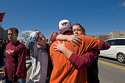 Blacksburg, Va. UNITED STATES: Virginia Tech students hug before a convocation and memorial April 17, 2007 for victims of the shooting massacre at Virginia Tech University in Blacksburg, Virginia. A 23-year-old student from South Korea was identifiedas the gunman who carried out the deadliest school shooting in US history.  33 people died on Monday, police named the gunman as Cho Seung-Hui, a student at the school and resident alien in the United States. (AMi Vitale)