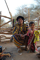 Niger, Agadez, Tidene, 2007. Rissa Ixa's wife and a neighbor's little girl relax in the early morning at their camp. She has many duties which will take up most of the day.