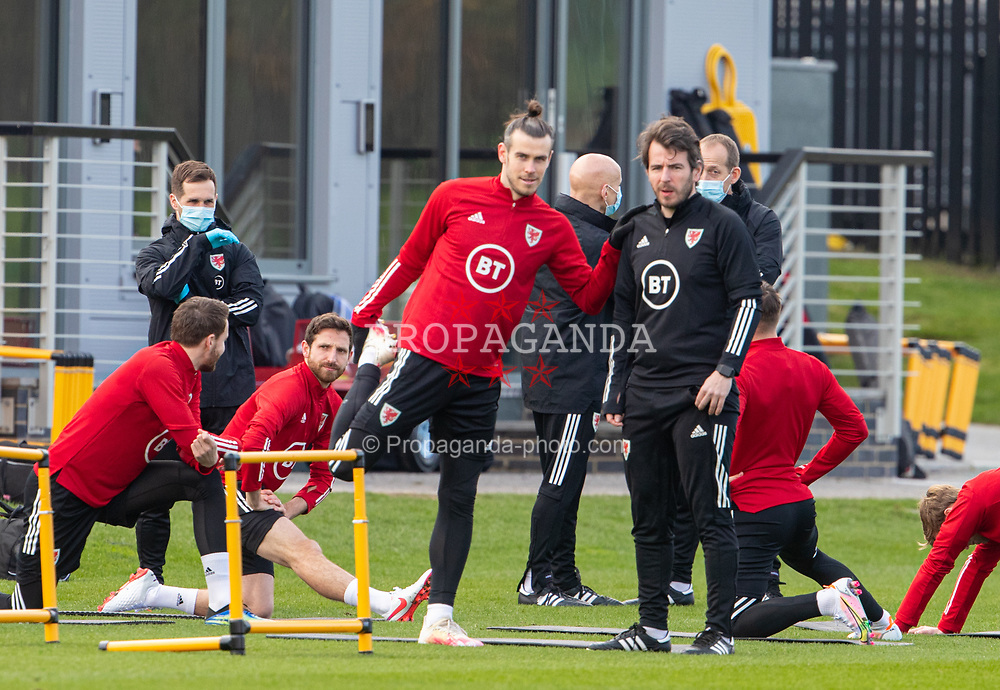 CARDIFF, WALES - Tuesday, March 23, 2021: Wales' captain Gareth Bale (L) and Ronan Kavanagh during a training session at the Vale Resort ahead of the FIFA World Cup Qatar 2022 Qualifying game against Belgium. (Pic by David Rawcliffe/Propaganda)