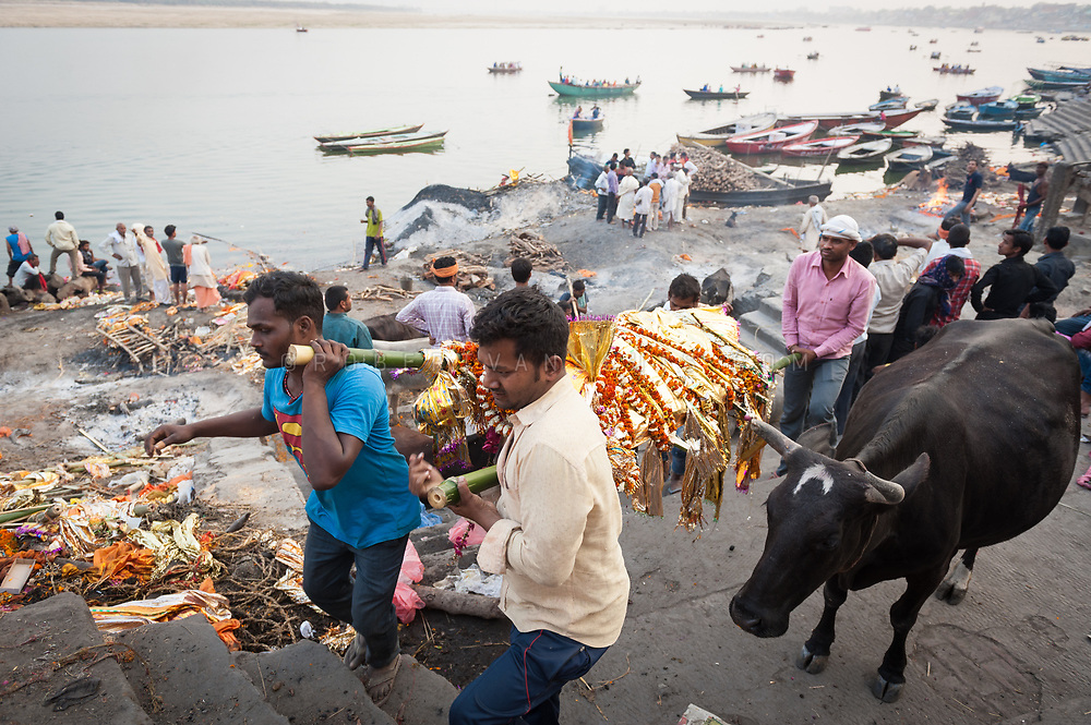 Family members carry a corpse to its funeral pyre at Manikarnika cremation ground, Varanasi, India. Photo © robertvansluis.com