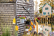 Maritime decor on an old boat house in the quaint fishing harbor of Port Clyde, Maine.