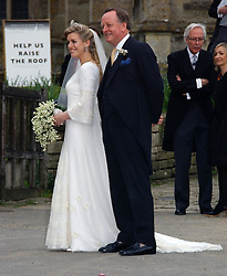 LAURA PARKER BOWLES and her father ANDREW PARKER BOWLES at the wedding of Laura Parker Bowles to Harry Lopes held at Lacock, Wiltshire on 6th May 2006.<br />