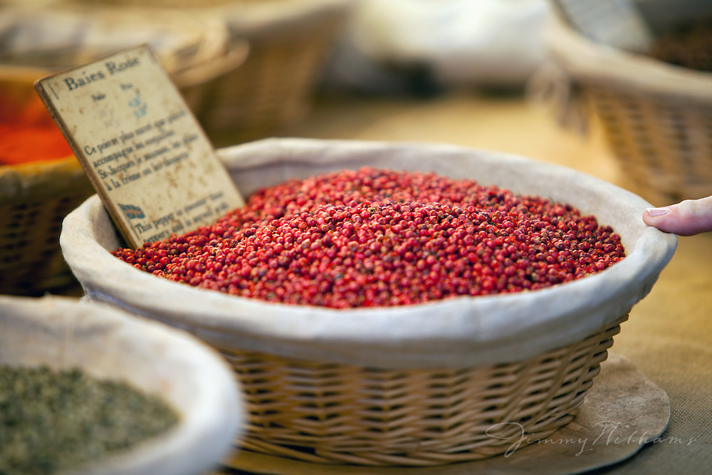A basket of french Baies Rose, a type of peppercorn, are sold at an outdoor market in Gordes, France