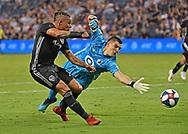 Sporting Kansas City forward Erik Hurtado (19) scores a goal against Minnesota United FC goalkeeper Vito Mannone (1) during the second half at Children's Mercy Park.