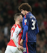Arsenal's Jack Wilshere clashes with Manchester United's Marouane Fellaini<br /> <br /> Barclays Premier League- Arsenal vs Manchester United - Emirates Stadium - England - 22nd November 2014 - Picture David Klein/Sportimage