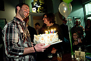 Family and friends celebrate Ethan Sterk's 40th birthday during a surprise party at Exit Strategy Brewing Company in Forest Park, Il. © 2016 Brian J. Morowczynski ViaPhotos