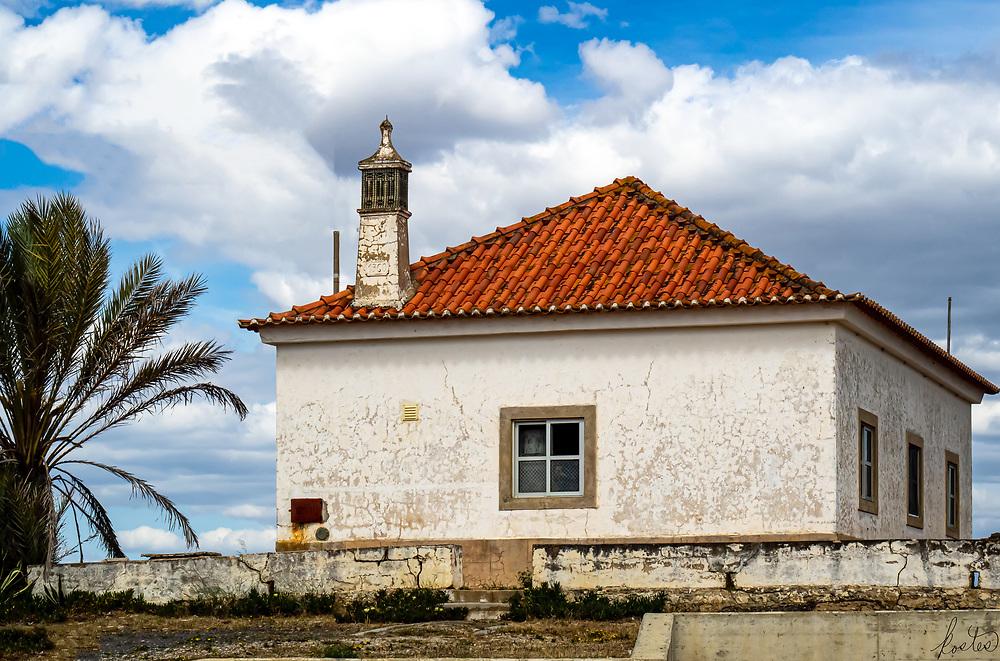 A weathered building along the Rio Guadiana in Villa Santo Antonio