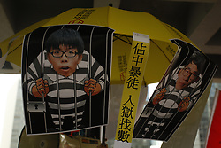 August 17, 2017 - Hong Kong, CHINA - The insulting caricatures depicting images of jailed Joshua Wong and Nathan Law are displayed outside High Court. Hong Kong pro-democracy activists and leading figures in 2014 UMBRELLA REVOLUTION, Joshua Wong, Nathan Law and Alex Chow are sentenced 6 to 8 months in jail respectively after High Court announced their verdict today. Aug 17,2017.Hong Kong.ZUMA/Liau Chung Ren (Credit Image: © Liau Chung Ren via ZUMA Wire)
