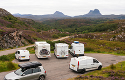 View of tourist camper vans and motorhomes in car park near Lochinver in Highland region of Scotland, UK