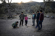Childrens playing ball nerbay the camp. About 20000 are living in a makeshift camp nearby the city of Moria on the island of Lesbos in miserable conditions, most of the without water, electricity nor sanitary facilities.  Federico Scoppa
