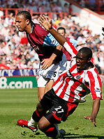 Photo: Paul Greenwood.<br />Sheffield United v West Ham United. The Barclays Premiership. 14/04/2007.<br />West Ham's Anton Ferdinand, (L) fouls Christian Nade leading to the free kick and goal