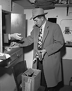 Y-490128-02.  Portland Police detectives confiscate dice.  Mike Elliot gambling raid. Ramapo Hotel basement, 1337 SW Washington January 28, 1949.