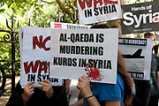 Demonstration against any intervention in Syria called by Stop the War and CND, August 30th 2013, Central London. Demonstrators hold placards including one saying 'Al-Qaeda is murdering Kurds in Syria'.