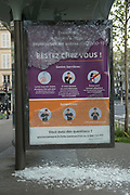 """April, 9th 2020 - Paris, Ile-de-France, France: Smashed glass Posters about the spread of the Coronavirus, during the first week of near total lockdown imposed in France. A week after President of France, Emmanuel Macron, said the citizens must stay at home for at least 15 days, that has been extended. He said """"We are at war, a public health war, certainly but we are at war, against an invisible and elusive enemy"""". All journeys outside the home unless justified for essential professional or health reasons are outlawed. Anyone flouting the new regulations is fined. Nigel Dickinson"""