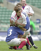 Twickenham, Surrey, 15th February 2003, Six Nationals International RFU Stadium, England,[Mandatory Credit: Peter Spurrier/Intersport Images], <br /> 2003 Women's International Rugby England v France<br /> Assunta De Baise is held iin the French Tackle, and look's for support.