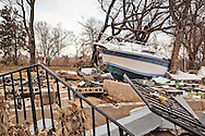 Union Beach NJ, November 16, Boat on the lawn of a home destroyed by superstorm Sandy's surge, that damaged over 200 homes in Union Beach alone. Hurricane Sandy's strength is being blamed on climate change by many scientists.