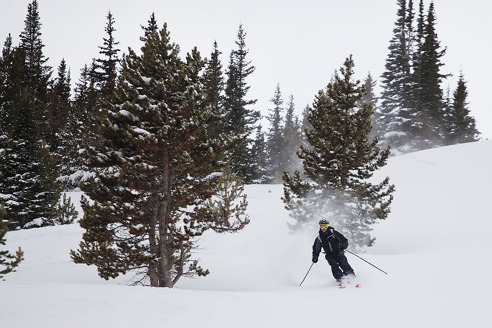 A skier catches turns on a backcountry ski tour to Jenny Lind Gulch, Arapaho National Forest, Colorado.