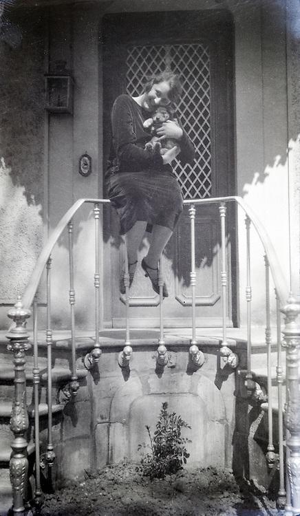 women cuddling a puppy dog 1920s