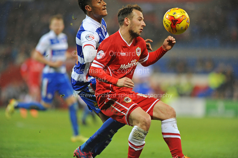 Adam Le Fondre of Cardiff City is challenged by Jordan Obita of Reading.<br /> Skybet football league championship match, Cardiff city v Reading at the Cardiff city stadium in Cardiff, South Wales on Friday 21st November 2014<br /> pic by Phil Rees, Andrew Orchard sports photography.