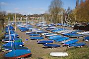 Sailing boats and dinghies in boatyard, Deben Sailing Club, Woodbridge, Suffolk, England