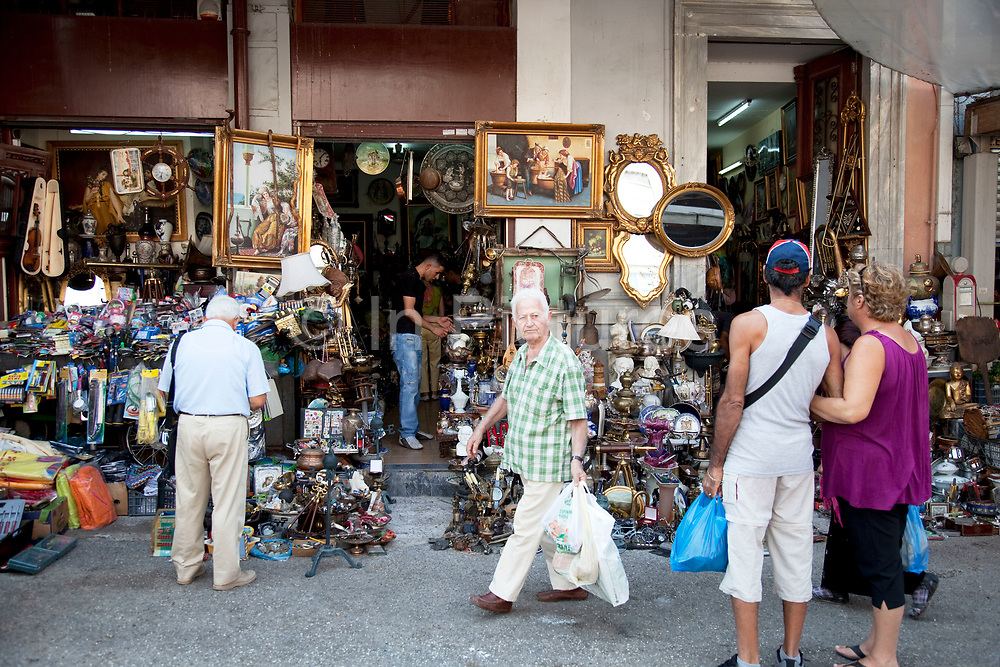 Antique shop in Omonia in the Athens Central Market area selling paintings, and general nik naks. Athens is the capital and largest city of Greece. It dominates the Attica periphery and is one of the world's oldest cities, as its recorded history spans around 3,400 years. Classical Athens was a powerful city-state. A centre for the arts, learning and philosophy.