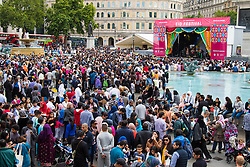 Trafalgar Square, London, July 25th 2015. Thousands of Muslims converge on Trafalgar Square in London to The Mayor of London's Eid In The Square Festival, celebrating the diversity of nationalities and cultures that make up London's Muslim community, with a wide variety of foods, dance and musical performances.